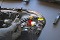 The side marker bulb and socket turn counter-clockwise and are pulled out from the assembly (yellow arrow).