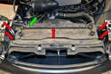 Use a T27 and remove the five Torx screws (red arrows) holding the plastic radiator cover on.