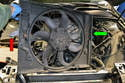 This photo illustrates the fan and shroud out of the engine bay.
