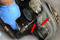 Remove the 13mm and 16mm bolts (red arrows) from the front, and slide the alternator forward.