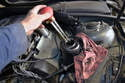 Use a turkey baster to drain as much fluid as possible from the power steering reservoir.