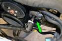 Remove the belt drive tensioner using a 17mm socket (green arrow) and breaker bar.