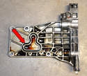 Shown here is the infamous alternator bracket gasket (red arrow).