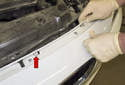 Unclip the retaining clips (red arrow) and pull the top of the bumper cover away from the radiator support.