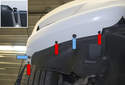 Working at bottom corners of bumper, remove the three 8mm fasteners (red arrows).
