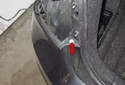 Working at the top of the rear bumper (where tail light mounts), remove the 10mm fastener (red arrow).