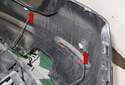 Disconnect parking sensor electrical connectors (red arrows).