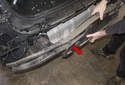 Then with help from a friend, slide bumper support off vehicle (red arrow).