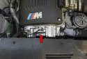 Variable camshaft timing (VANOS): VANOS (red arrow) is the BMW term for variable camshaft timing.