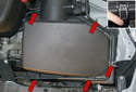 Next, you will unclip the five-air filter housing retaining clips (red arrows).