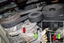 Locate the AC drive belt tensioner.