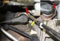 Next, using a 5mm Allen bit (yellow arrow), remove the crankshaft sensor mounting fastener (red arrows).