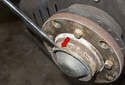 Remove the front wheel from the side of the vehicle you are replacing the wheel bearing on.