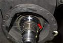 Next, remove the wheel bearing (red arrow) from the steering knuckle.