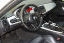 The instrument cluster (red arrow) on BMW Z4 models incorporates multiple information gauges that display engine operation information.