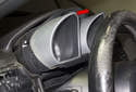 Next, pull the top of the instrument cluster straight out of the dashboard (red arrow).