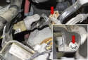 Working in the engine compartment below the brake booster at the top of the steering shaft, remove the E10 External Torx fastener (red arrows).
