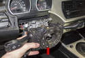 Remove the steering wheel and steering column switch assembly (red arrow).