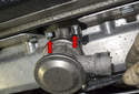Next, remove the two 10mm nuts (red arrows) from the bottom of the check valve.