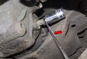 Working at rear differential, using a 14mm Allen bit, remove the oil fill plug (red arrow).