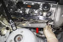 Lift and remove the heat shield (red arrow).