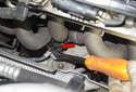 B1S1: Using an oxygen sensor socket (red arrow), loosen the oxygen sensor connection to the exhaust manifold.