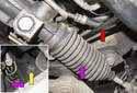 Next, working at the subframe, remove the inner ball joint 21mm nut (yellow arrow).