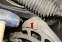 Knock the ball joint out of the subframe using a hammer.