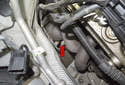 The exhaust gas temperature (EGT) sensor is mounted in the exhaust header (red arrow) on BMW Z4M models with an S54 engine.