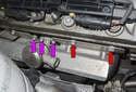 Then, remove the three 10mm fasteners (purple arrows) then remove the secondary air check valve, remove the 13mm heat shield fasteners (red arrows).