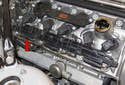 Locate the EGT sensor electrical connectors at the rear of the cylinder head (red arrow).