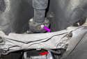 Working at the transmission, remove the six, 16mm driveshaft flex-disc fasteners (purple arrow).
