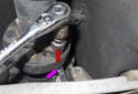 Keep the transmission in neutral so you can rotate the driveshaft, remove the six, 16mm driveshaft flex-disc fasteners (red arrow).