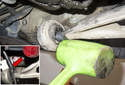 Slide the pickle fork (red arrow) over control arm and behind bushing.