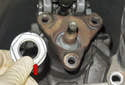 Counterhold the flange and remove the 30mm nut (red arrow).
