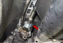 I like to use a 3-jaw puller (red arrow) to remove the flange from the transmission.