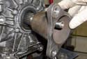 Then slide the flange off the transmission output shaft.