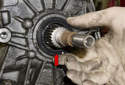 To install a new seal, slide it over the output shaft and press it in by hand.