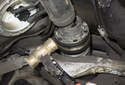 Using a soft-faced hammer, tap the end of the driveshaft to break free the connection to the differential.