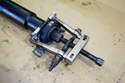 Use a bearing puller and puller to pull the center support bearing off of the front half of the driveshaft.