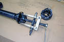 If you are replacing the driveshaft CV joint you can now use a two arm puller to remove the inner CV joint race.