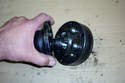 Rotate the CV joint outer race to expose the first few ball bearings.