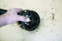 Rotate the outer race over the ball bearings you have installed.