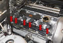 BMW Z4 models equipped with a 6-cylinder engine utilize an individual ignition coil for each spark plug, referred to as coil over plug (red arrows).