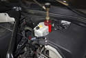 Then install the pressure bleeder adapter to the brake master cylinder (red arrow).