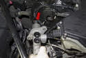 Start by removing the brake master cylinder (red arrow).
