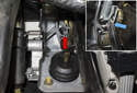Working next to the brake pedal underneath the dashboard, remove the brake pedal shaft clip (red arrow).