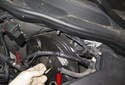 Pull the brake booster (red arrow) out of the firewall and angle it toward the right side of the vehicle.