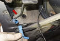 Open the sensor connector housing door (red arrow).