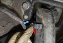 Remove the sensor wiring harness (blue arrow) from the mounts (red arrows) on the trailing arm.